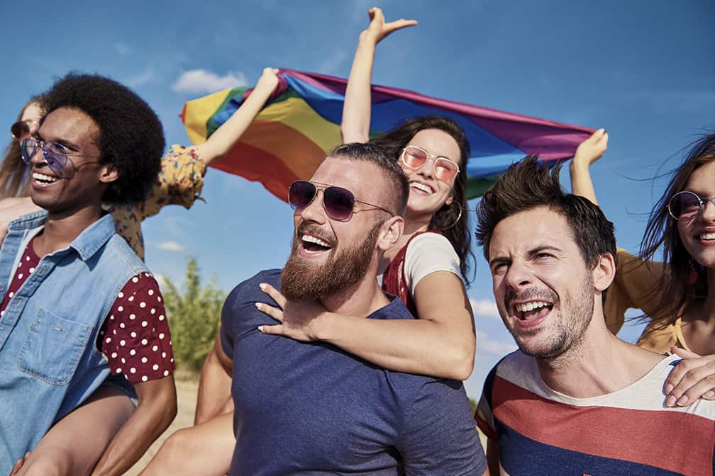 Happy People Holding a Flag
