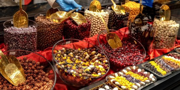 Chocolate truffles, candies and sweets store on showcase in factory store. Chocolate bit sized for sale in local chocolate store